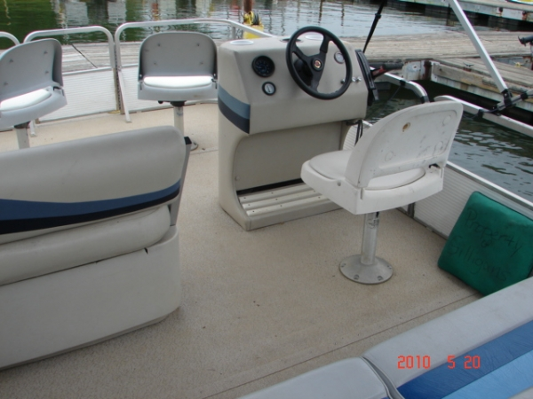 Pontoon Boat equipped with a 25 hp 2-cycle outboard motor.
